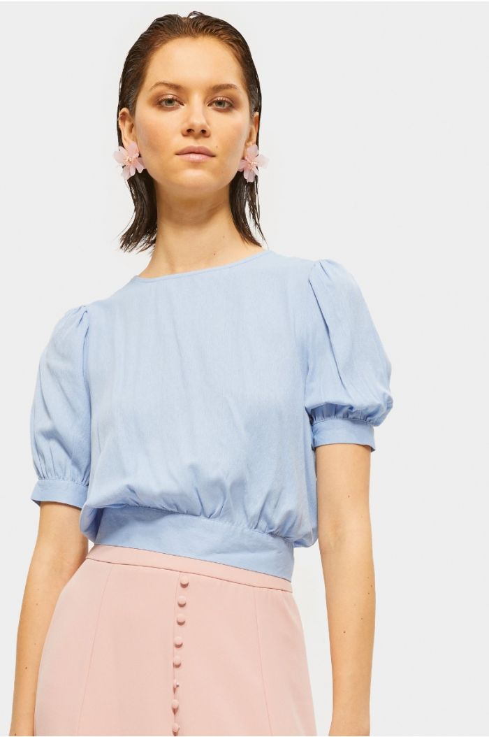 Plain blouse with puffed sleeves and back strap
