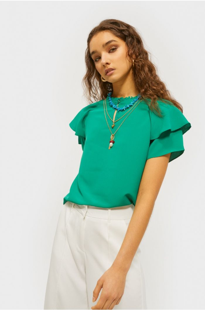 Plain blouse with ruffles
