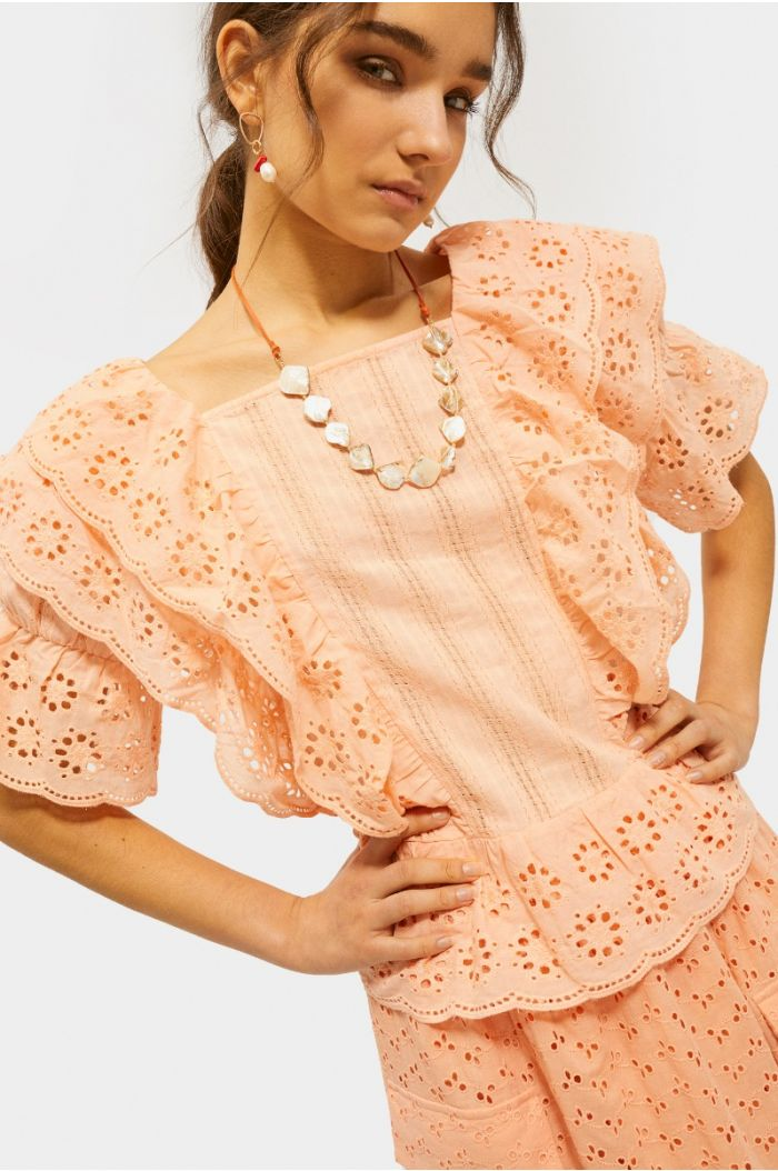Blouse with ruffles and laser cuts