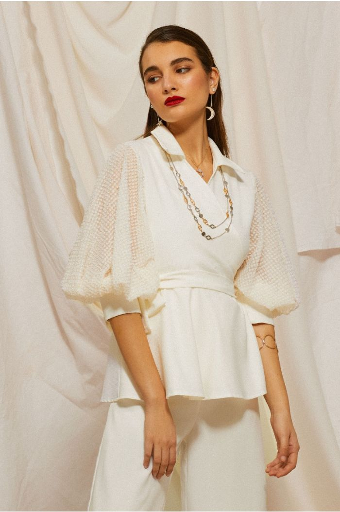 Wrap top with textured puffed sleeves
