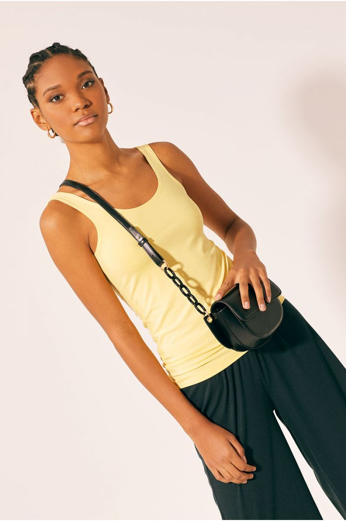 Model wears Plain tank top with wide straps