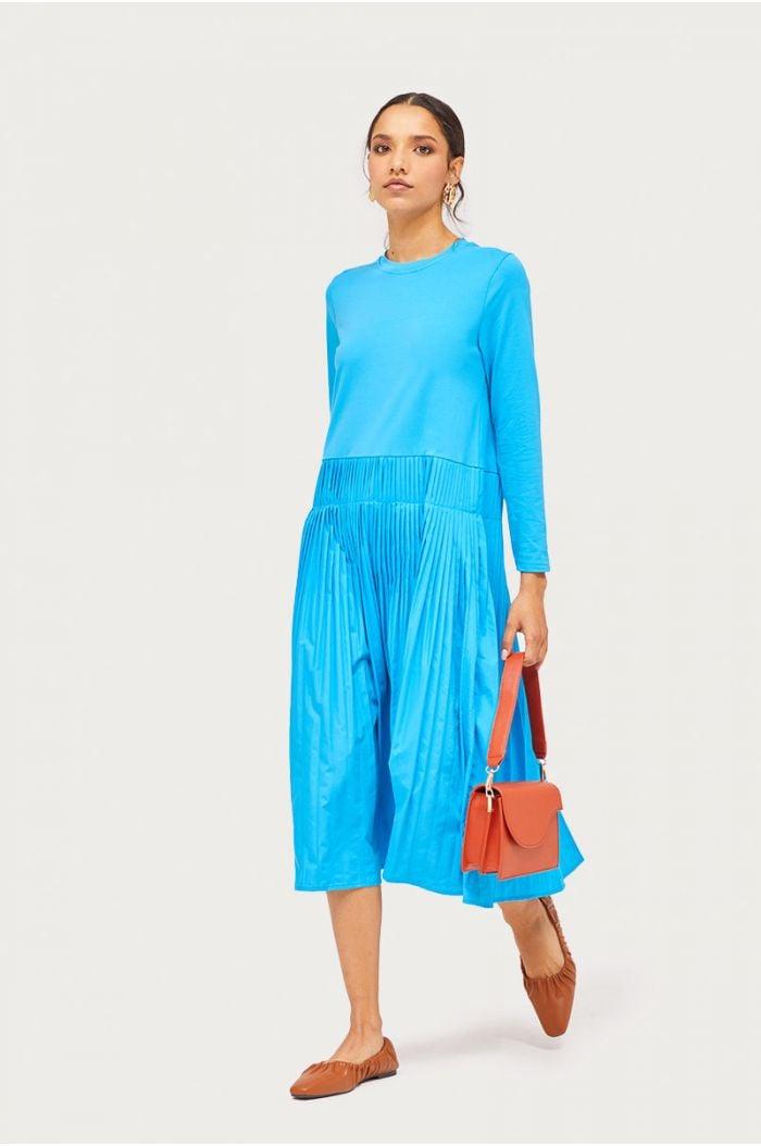 Model wears Pleated contrast midi dress