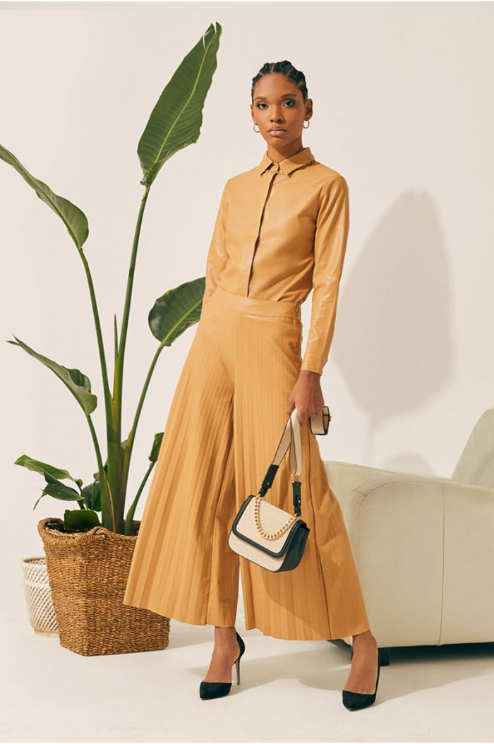 Wide cut pleated pants with leather look fabric