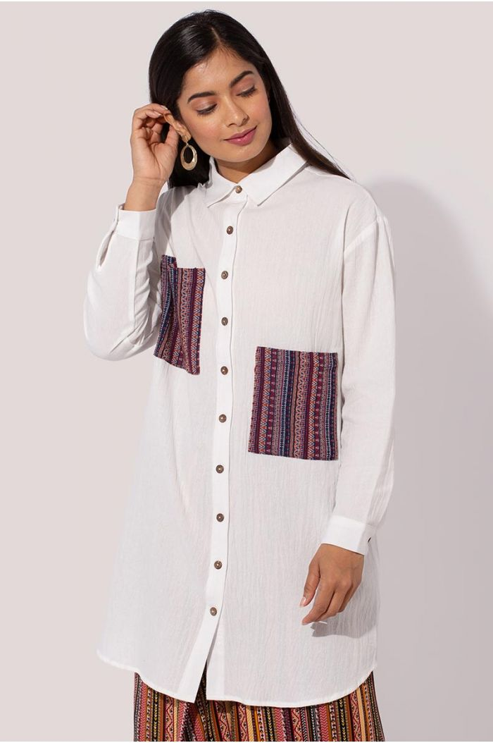 Model wears Long shirt with pockets printed with traditional Sadu print