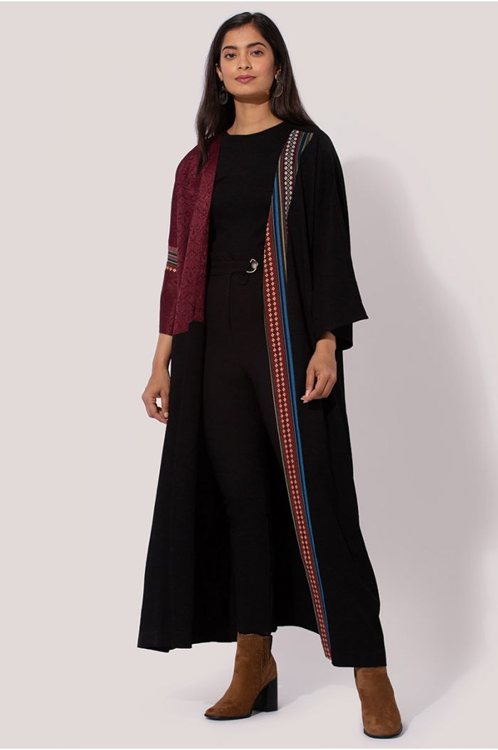 Model wears Abaya with traditional Sadu print and contrast fabric