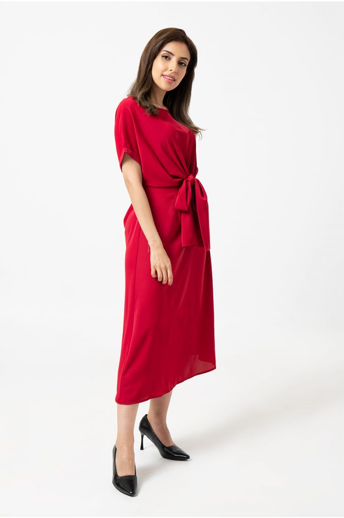 Model Wears  Knee high dress with a twisted wrap