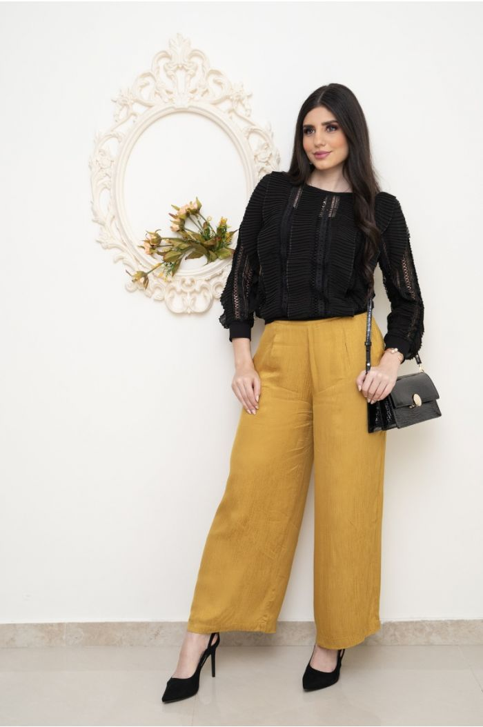 Ruffled blouse with cutwork embroidery